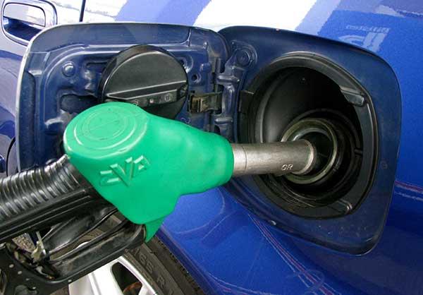 Filling up a petrol-driven car.