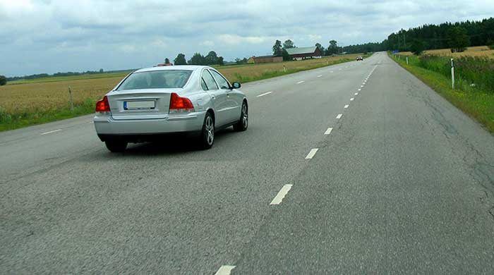 Drive on the hard shoulder to assist the silver car overtaking you.